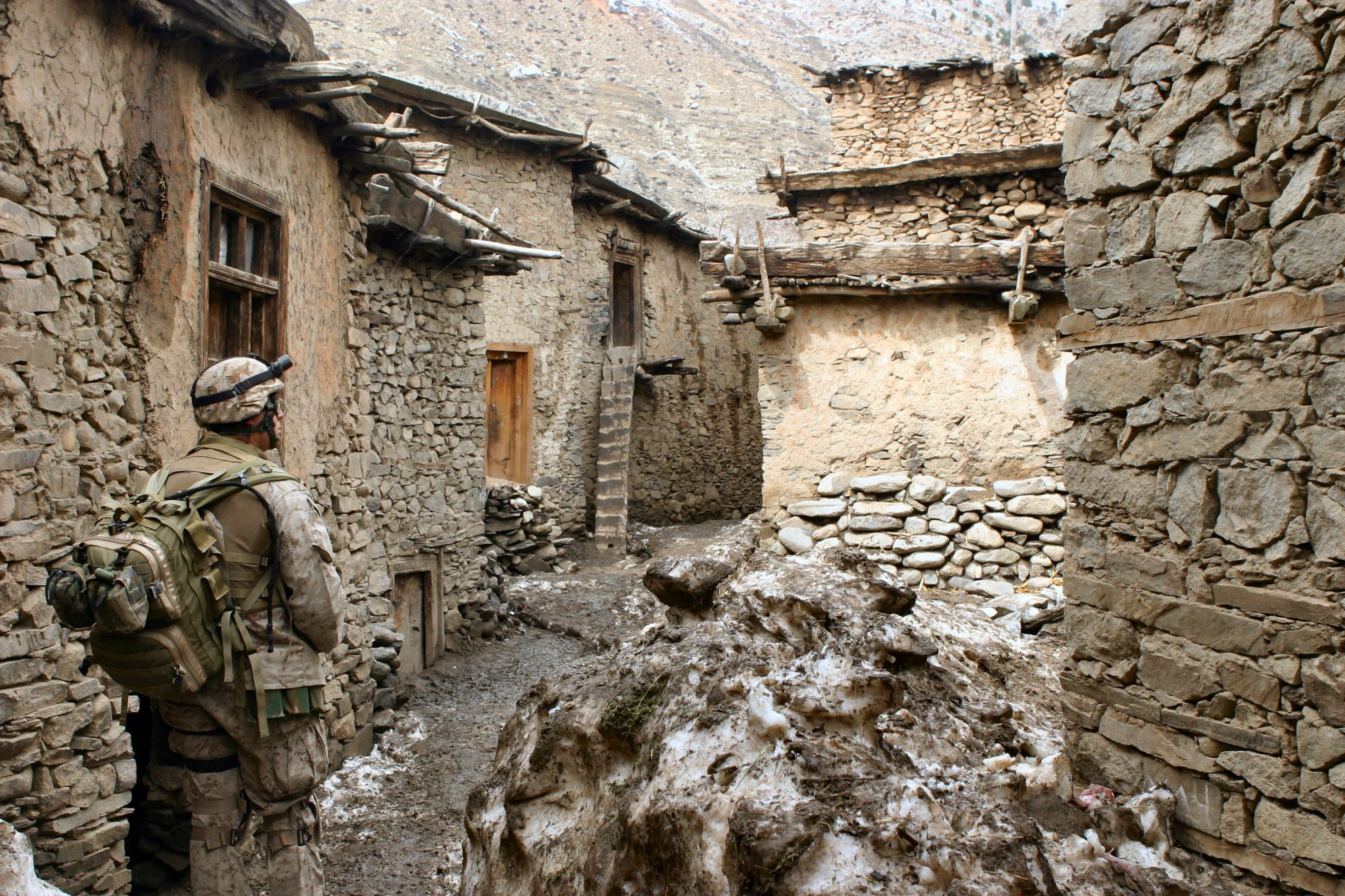 Petty Officer 2nd Class Alonzo Gonzales, a Hospital Corpman with Kilo Company, 3rd Battalion, 3rd Marine Regiment, walks through an alley looking for signs of sickness or disease during Operation Mavericks, an operation that Marines conducted to capture suspected Anti Coaltion Forces in the vicinity of Methar Lam, Afghanistan on March 19, 2005. 3rd Battalion, 3rd Marines is conducting security and stabilization operations in support of Operation Enduring Freedom. (U.S. Marine Corps photo by Corporal James L. Yarboro) Released